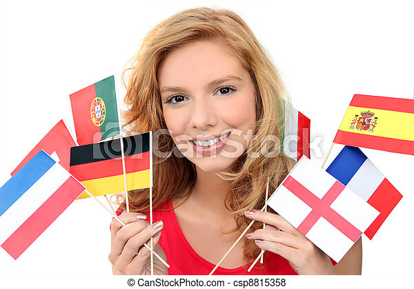 girl holding a bunch of national flags - csp8815358