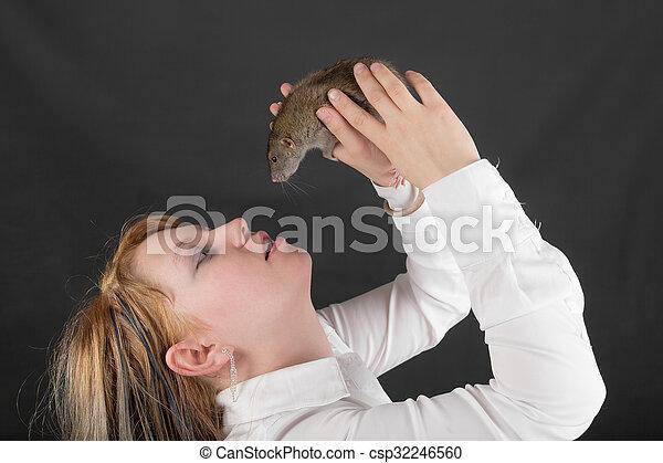 girl holding a pet rat - csp32246560