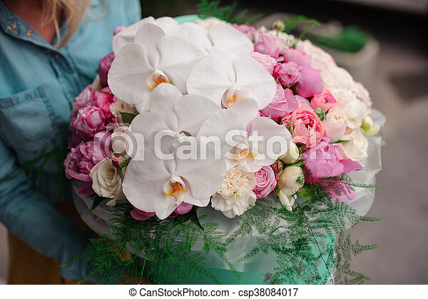 Girl holding beautiful mix white and pink flower bouquet in round girl holding beautiful mix white and pink flower bouquet in round box with lid csp38084017 mightylinksfo