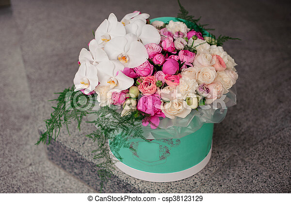Girl holding beautiful mix white and pink flower bouquet in round girl holding beautiful mix white and pink flower bouquet in round box with lid csp38123129 mightylinksfo