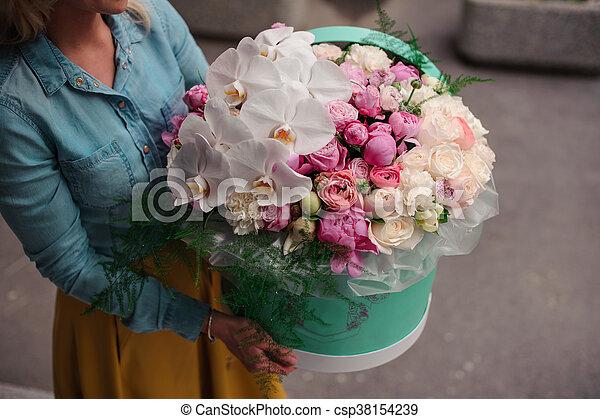 Girl holding beautiful mix white and pink flower bouquet in round girl holding beautiful mix white and pink flower bouquet in round box with lid csp38154239 mightylinksfo