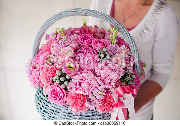 Girl Holding Beautiful Pink Bouquet Of Mixed Flowers In Basket Girl Holding Big Beautiful Pink Bouquet Of Mixed Flowers In Canstock