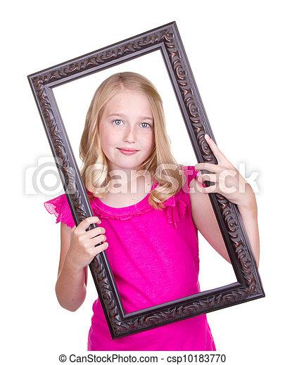 Girl holding frame around face, isolated on white.