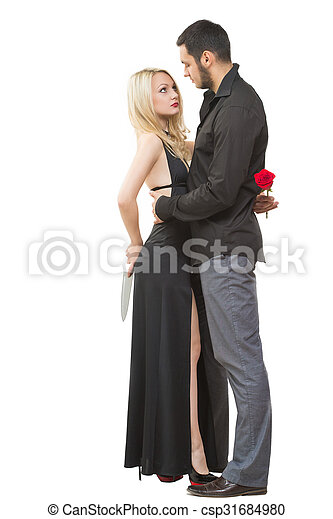 Girl holding knife traitor. man with rose in his hand ...