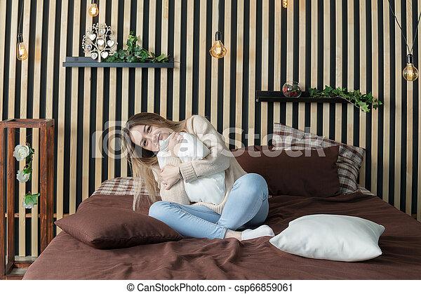 girl hugging a pillow - csp66859061