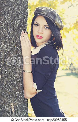 girl in a cap - csp23983455