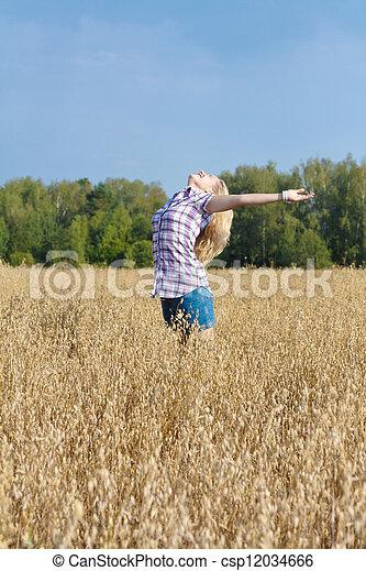 girl in a field - csp12034666