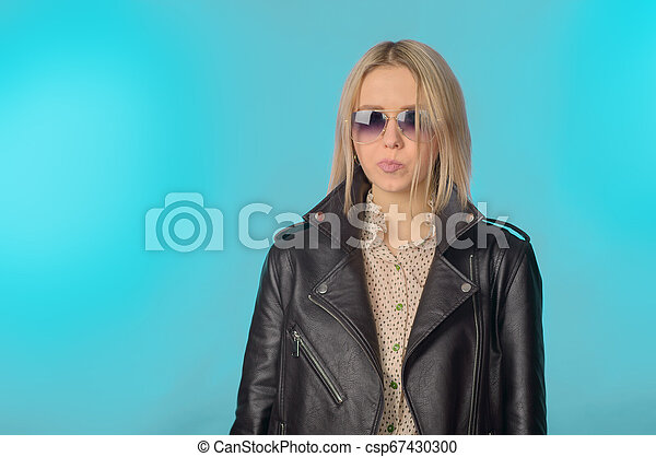 Girl in a leather jacket in retro style - csp67430300