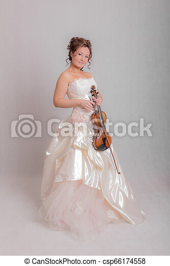 girl in a white dress with a violin - csp66174558