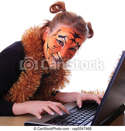 Girl in appearance a tiger with a notebook. - csp5547468