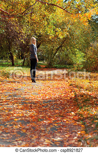 girl in autumn park - csp8921827