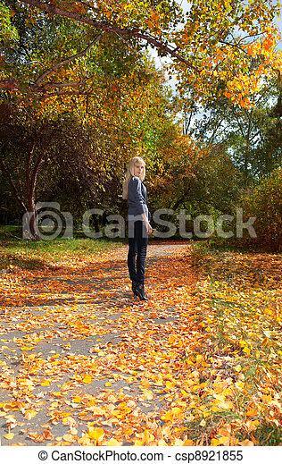 girl in autumn park - csp8921855