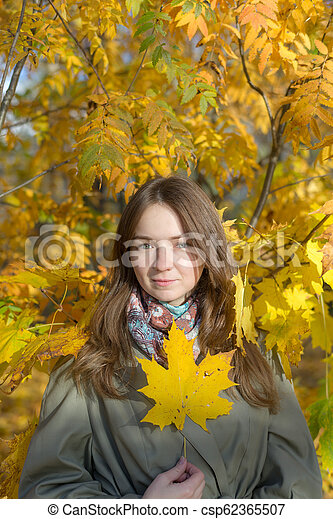girl in autumn park - csp62365507