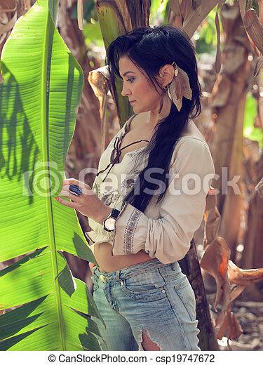 girl in bananas plantation - csp19747672