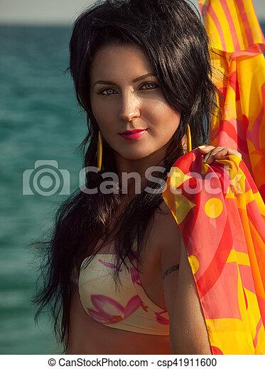 girl in bikini and pareo at sea background - csp41911600