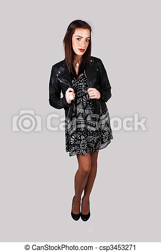 26e4764c4cc Girl in black dress and leather jacket.