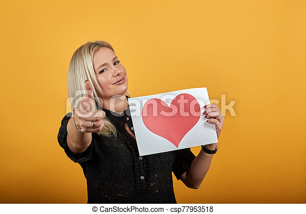 Girl In Black Dress Happy Woman In Love Holding Piece Of Paper With Red Heart Beautiful Blonde Girl In Black Dress On Yellow
