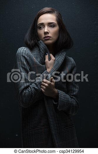 Girl in coat - csp34129954