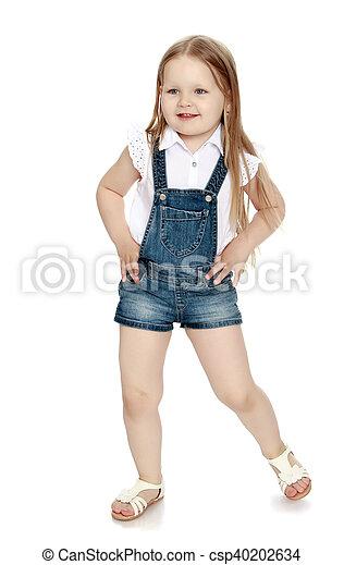 58cc9b54104 Girl in denim shorts. Beautiful little girl with long blonde hair ...