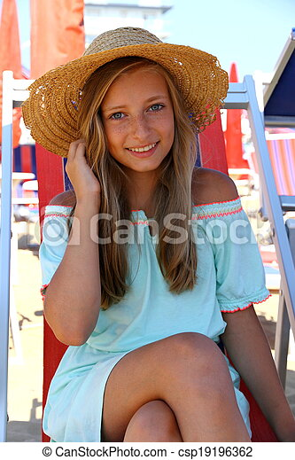 girl in hat on beach - csp19196362