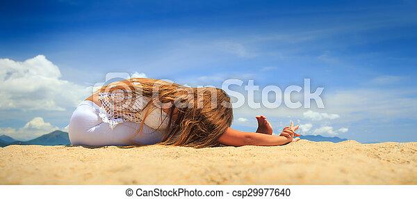 girl in lace sits in yoga asana headtoknee forward bend