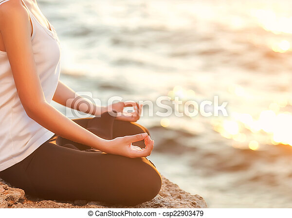 girl in lotus pose at sunset silhouette young woman
