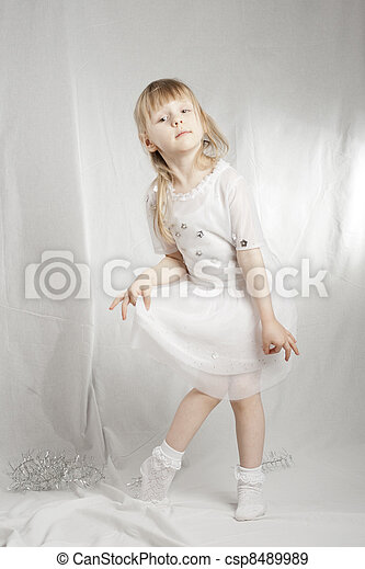 Girl in snowflake costume on white background - csp8489989
