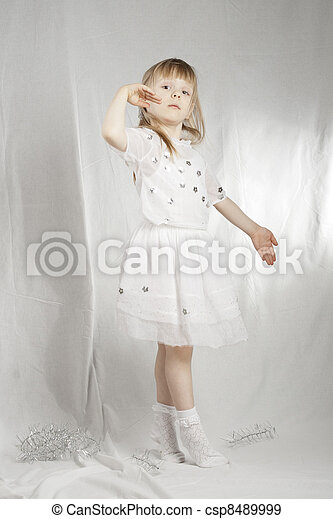 Girl in snowflake costume on white background - csp8489999