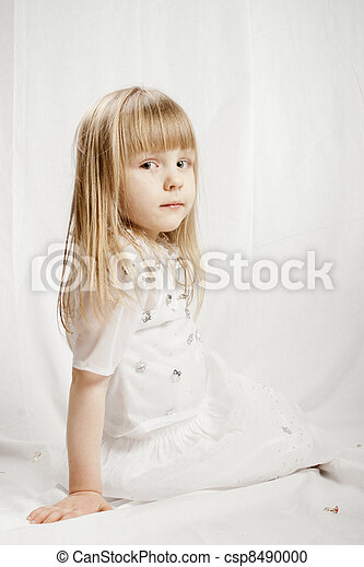 Girl in snowflake costume on white background - csp8490000