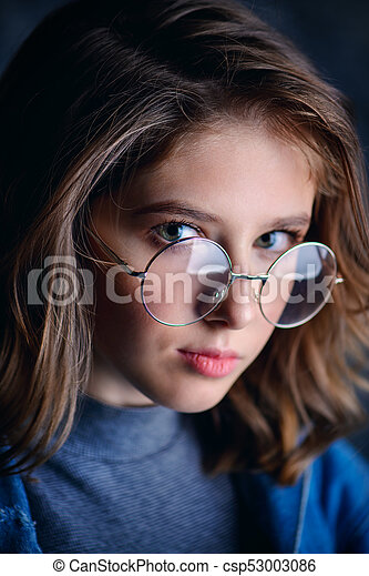 bc568aa2b94 Girl in spectacles. Portrait of a cute girl teenager wearing ...
