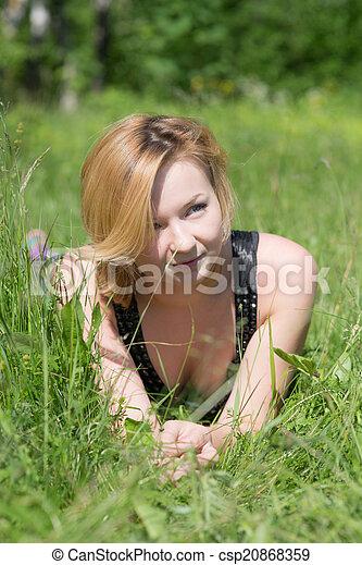girl in summer grass - csp20868359