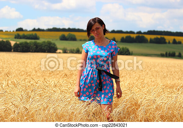 Girl in wheat field - csp22843021