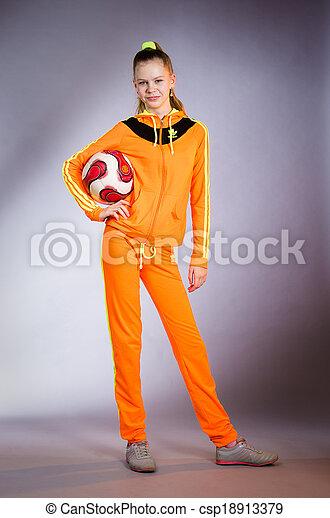 girl in yellow sportwear costume - csp18913379