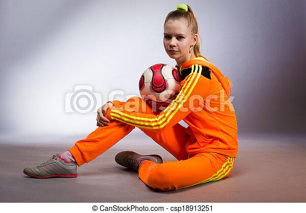 girl in yellow sportwear costume - csp18913251