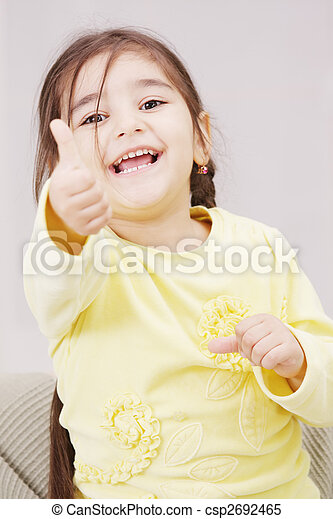 Girl in yellow with thumb up - csp2692465