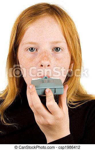 Girl inhaling asthma medicine - csp1986412