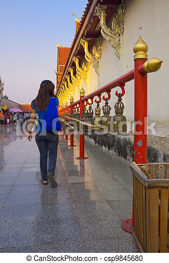 Girl is knocking the bell for her good wish - csp9845680