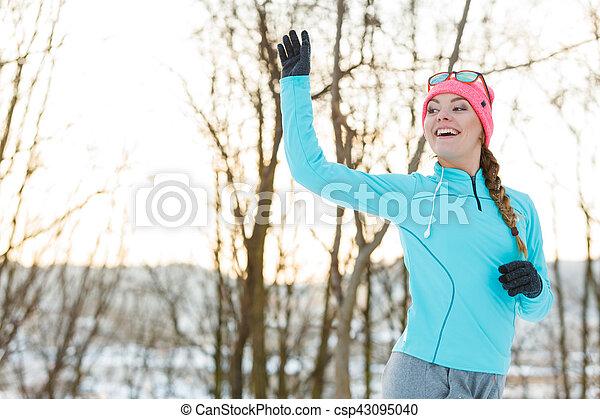 Girl jogging in winter park - csp43095040
