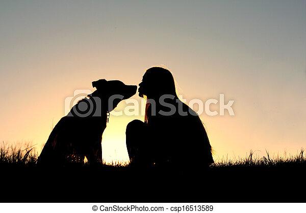 girl kissing dog silhouette