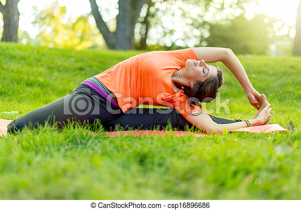 girl meditating and doing yoga at sunsets portrait of a