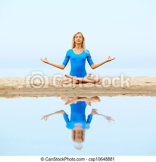girl meditating on beach outdoor portrait of young