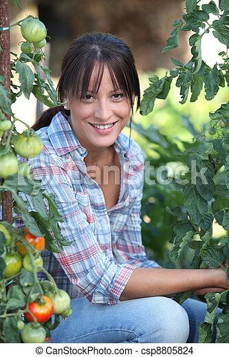 Girl next to tomatoes - csp8805824