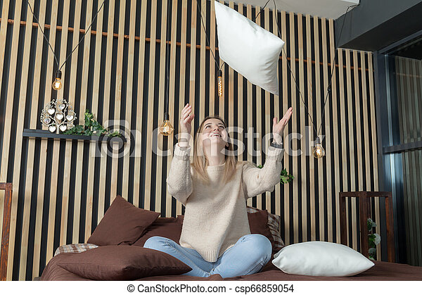 girl on a bed with pillows - csp66859054