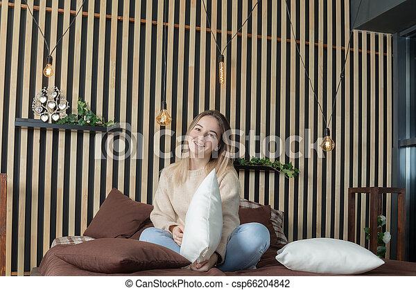 girl on a bed with pillows - csp66204842