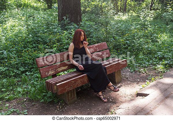 girl on a bench - csp65002971