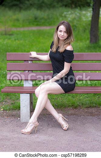 girl on a bench - csp57198289