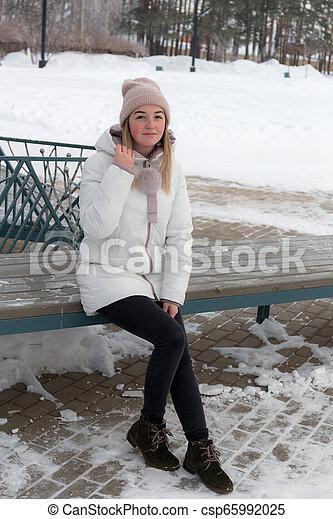 girl on a bench - csp65992025