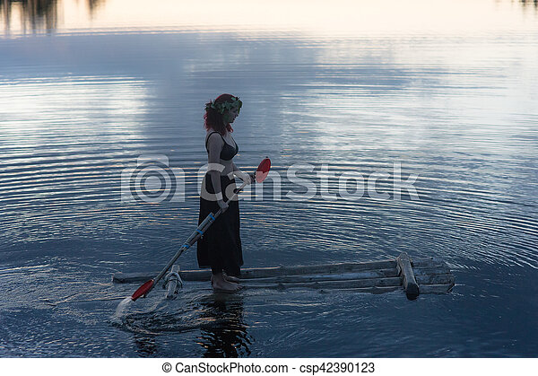 girl on a raft in the night - csp42390123