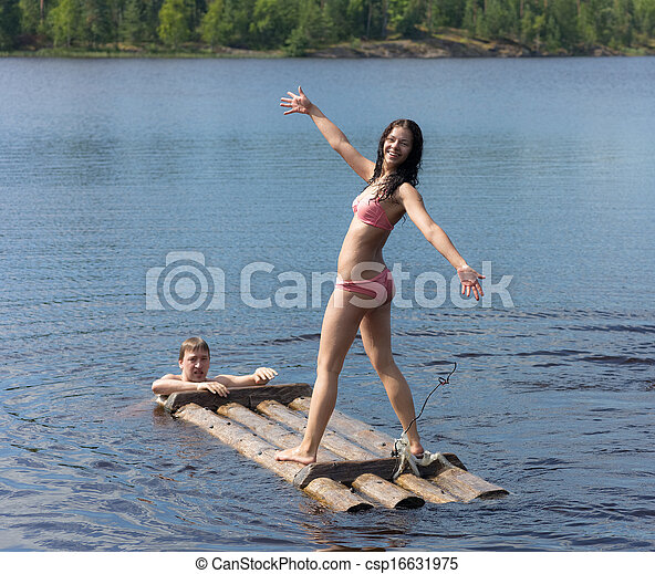 girl on a wooden raft - csp16631975