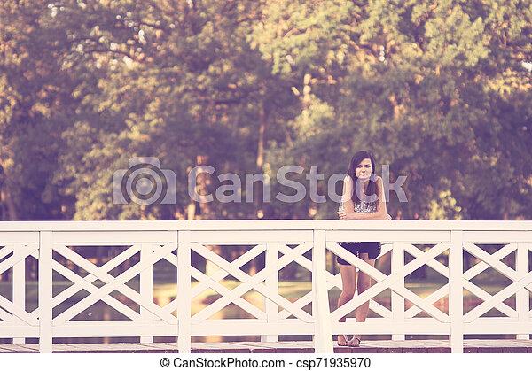 Girl on bridge - csp71935970